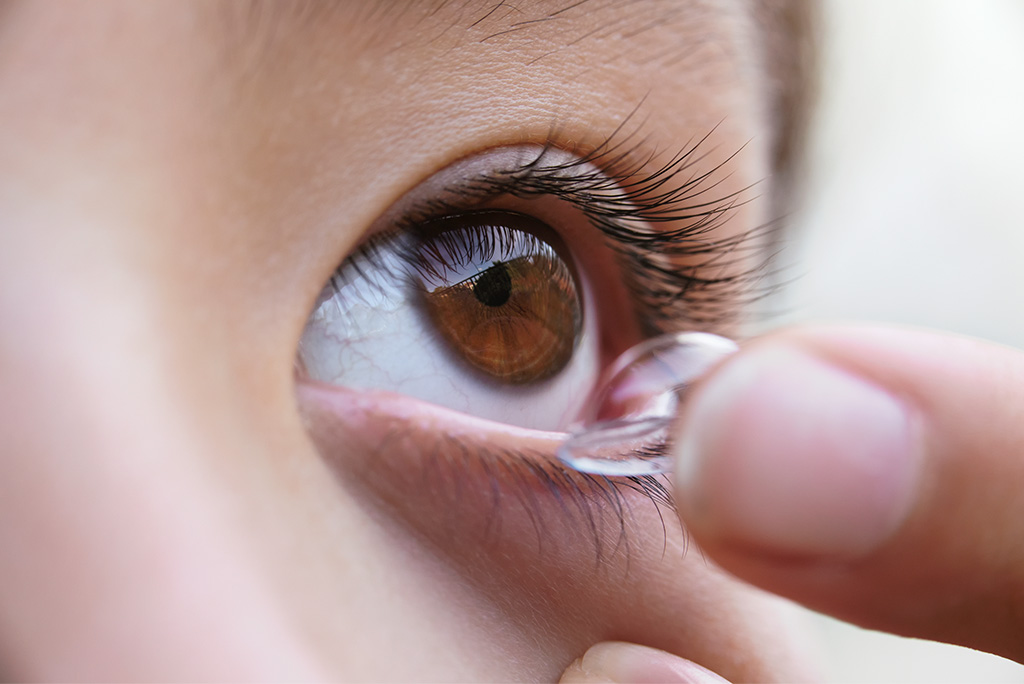 Child putting in a contact lens